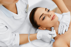 Face Skin Care. Diamond Microdermabrasion Peeling Treatment, Bea. Face Skin Care. Closeup Of Beautiful Woman Getting Diamond Microdermabrasion Peeling Treatment Stock Image