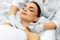 Face Skin Care. Diamond Microdermabrasion Peeling Treatment, Bea. Face Skin Care. Closeup Of Beautiful Woman Getting Diamond Microdermabrasion Peeling Treatment Stock Images