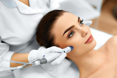 Face Skin Care. Facial Hydro Microdermabrasion Peeling Treatment stock photos