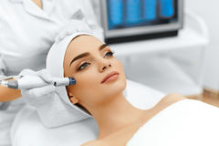Face Skin Care. Facial Hydro Microdermabrasion Peeling Treatment. Face Skin Care. Close-up Of Woman Getting Facial Hydro Microdermabrasion Peeling Treatment At Royalty Free Stock Image