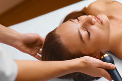 Face skin care treatment. Ultrasound cavitation procedures. Royalty Free Stock Photography