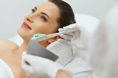 Face Skin Care. Woman Doing Alginate Facial Mask At Cosmetology royalty free stock image
