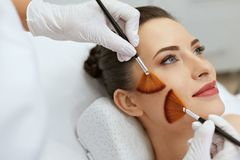 Face Skin Care. Woman Gets Brushes Treatment At Beauty Clinic stock photos