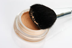 Face skin powder and brush. For make-up stock photo