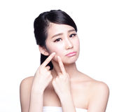 Face Skin Problem. Young woman unhappy touch her skin isolated, concept for skin care, asian Stock Photo