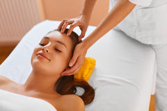 Face skin. Woman receiving facial spa treatment, massage. Stock Photos