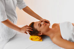 Face skin. Woman receiving facial spa treatment, massage. Stock Photo