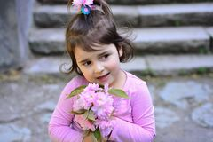 Face and skincare. allergy to flowers. Little girl in sunny spring. Springtime. weather forecast. Summer girl fashion. Happy childhood. Small child. Natural stock images
