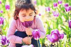 Face skincare. allergy to flowers. Springtime tulips. weather forecast. Summer girl fashion. Happy childhood. Little stock photo