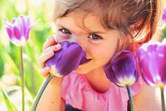 Face skincare. allergy to flowers. Springtime tulips. weather forecast. Summer girl fashion. Happy childhood. Little. Girl in sunny spring. Small child. Natural stock images
