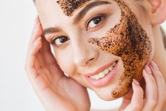 Face Skincare. Young charming girl makes a black charcoal mask o. N her face royalty free stock image