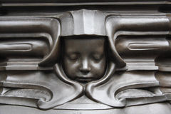 Face of a Sleeping Child. These faces surround the base of the statue of Queen Victoria outside St Nicholas' Church, Newcastle upon Tyne Royalty Free Stock Photo