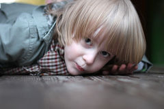 Face of small blond boy creeping Royalty Free Stock Photo