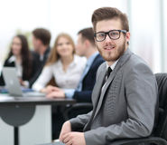 Face of  smart businessman on the background of business people Stock Photo