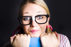Face of smart schoolgirl holding textbook on black Royalty Free Stock Photos