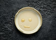 Face smile made with honey drops on lid stock images