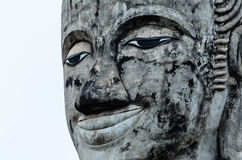 Face of Smile Old Buddha. The Face of Smile Old Buddha Royalty Free Stock Photos