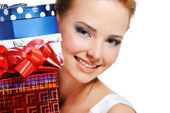 Face of smiling girl with the many presents Stock Images