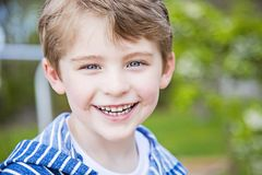 Face of smiling happy boy outside Royalty Free Stock Photo