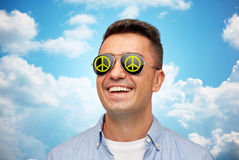 Face of smiling man in green peace sunglasses Royalty Free Stock Photography