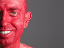 Face smiling man makeup red Stock Photography