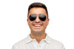 Face of smiling man in polo t-shirt and sunglasses Stock Image