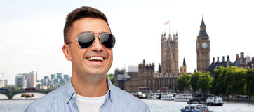 Face of smiling man in shirt and sunglasses Stock Photo
