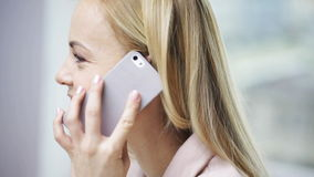 Face smiling woman calling on smartphone stock video footage