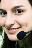 Face of smiling woman in headphones Stock Photography