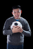 Face of soccer lover holding football ball isolated black backgr Royalty Free Stock Photo
