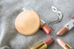 Face sponge powder and lipstick Royalty Free Stock Photography