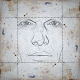 Face on stained paper Stock Photo