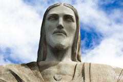 Face of the statue of Christ the redeemer in Rio de Janeiro. Against blue sky Royalty Free Stock Image