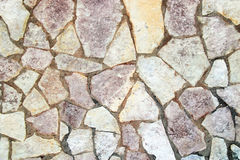 Face of the stone. External plaster covered with a mosaic of stones Stock Photos