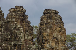 Face stone of ancient Bayon Temple in Angkor Wat, Siem Reap, Cambodia Stock Photo