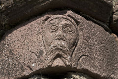 A face in the stone at Innisfallen Abbey on Innisfallen Island Stock Photography