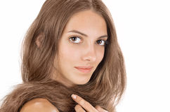 Face studio portrait of young lady with long hairs Royalty Free Stock Images