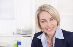 Face of a successful mature business woman in the office. Stock Images