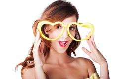 Funny woman with heart shape sunglasses Royalty Free Stock Images