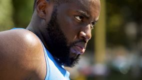 Face of sweating Afro-American athlete seriously looking forward, motivation stock photo