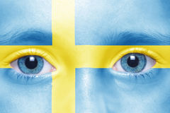 Face with swedish flag. Child`s face with swedish flag Stock Photo