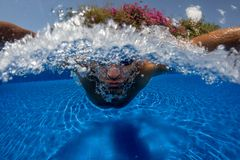 Man breath while swim. Face of swimming man in pool blue water close up Royalty Free Stock Images