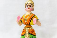 Face of a Thanjavur dancing doll Called as Thalaiyatti Bommai in Tamil language with look alike traditional dress and oranments Royalty Free Stock Photography