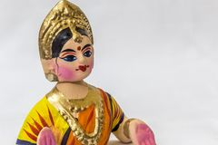 Face of a Thanjavur dancing doll Called as Thalaiyatti Bommai in Tamil language with look alike traditional dress and oranments Royalty Free Stock Photo