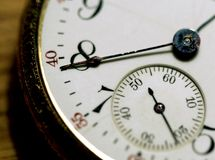 Face Of Time. A closeup image of an old pocketwatch. Theme is time and business timing stock photography