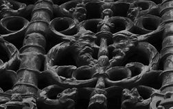 Face to face on the cloister. Shot in black and white, detail on the sculpture on the cloister of this historic church Santa Maria la Real representing some Stock Photography