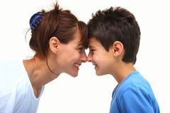 Face to face. A smiling mother with her happy son face to face isolated on a white background Royalty Free Stock Photography