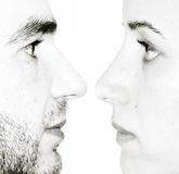 Face to face. Men and woman profile on the black background royalty free stock photo
