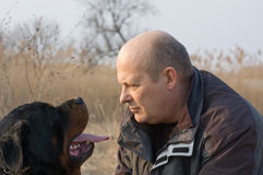 Face to face. Man and rottweiler dog face to face Royalty Free Stock Photos