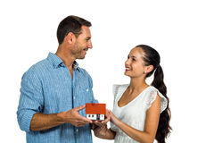 Face to face couple holding house model Stock Image